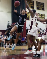 New Rochelle Aniya Jones (5) goes up for a shot in front of Mt. Vernon's Sanaah Hamilton (24) during  girls basketball action at Mt. Vernon High School Jan. 9, 2020. New Rochelle won the game 61-51.
