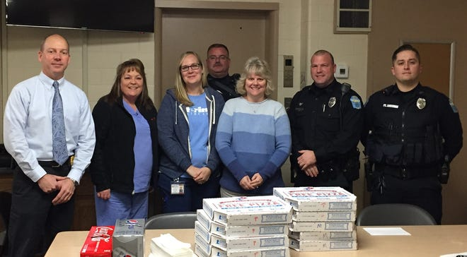 Capt. Scott Comstock and Zanesville Police officers with employees of Interim Health during Thursday's Law Enforcement Appreciation Day celebration.