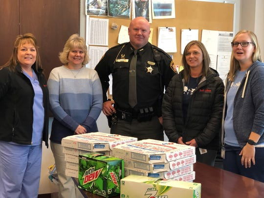 Sgt. Chris Merry represented the Muskingum County Sheriff's Office Thursday when Interim Health employees delivered pizza for Law Enforcement Appreciation Day.