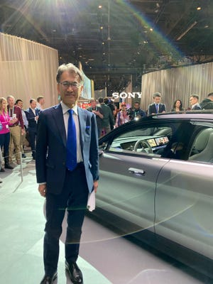 Sony CEO Kenichiro Yoshida  in front of the company's Vision-S electric vehicle prototype at CES.