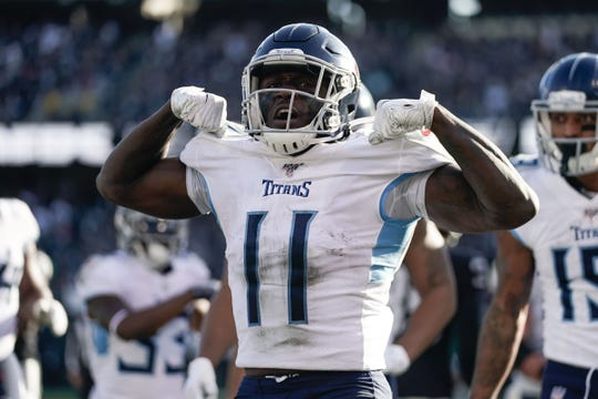 Tennessee Titans wide receiver A.J. Brown (11) celebrates after scoring a touchdown against the Oakland Raiders during the second quarter at Oakland Coliseum.