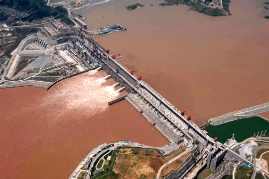 In this July 2006 file photo released by China's Xinhua News Agency, an aerial view of the Three Gorges dam is seen on the Yangtze River in Yichang, central China's Hubei Province.