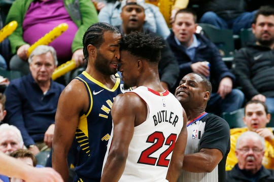 Miami Heat forward Jimmy Butler (22) gets up in the face of Indiana Pacers forward T.J. Warren (1) as an argument ensued resulting in double technical fouls during the third quarter at Bankers Life Fieldhouse.