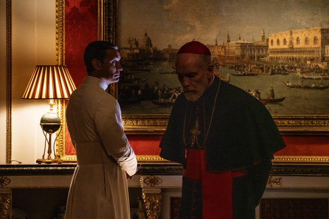 Jude Law, left, plays Pope Pius XIII and John Malkovich plays Pope John Paul III in HBO's 'The New Pope.'