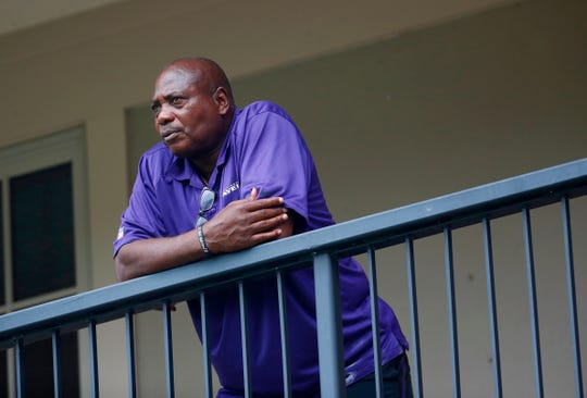 On July 28, 2017, a file photo, Baltimore Ravens General Manager and Executive Vice President Ozzie Newsome look for a training ground after a practice session at an NFL football training camp in Owings Mills, Md.