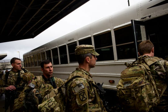 Soldiers with the 82nd Airborne Division board a bus to be taken to a flight line as they deploy to the Middle East on Saturday, Jan. 4, 2020 at Fort Bragg, N.C.