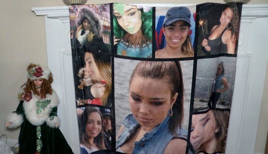 A blanket filled with photos of Stephaine Parze hangs on a fireplace in the family's Freehold home Thursday, January 9, 2020.  It was given to the family by one of the volunteers who helped to search for the missing woman.