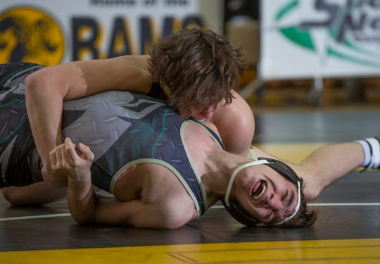 Southern's Cole Velardi (right) pins Brick Memorial's J.T. Henderson in the 160-pound bout of the Rams' 41-23 win over Brick Memorial Thursday night.
