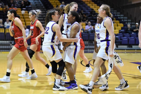 Hardin-Simmons guard Logan Haller (22) is congratulated by Jesyka Lee (23), Parris Parmer (3), Taylor Gaffney (10) and Miranda Goswick (50) after making the record-breaking 3-pointer at the end of the third period. The Cowgirls made a record 17 3s in their 82-61 win against Sul Ross State at the Mabee Complex on Thursday, Jan. 9, 2020.