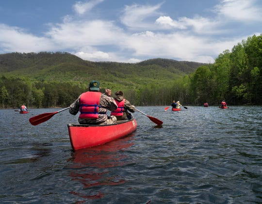 Canoeists paddle across Clear Creek in South Mountains State Park. The new Wilderness Gateway State Trail will include two paddle trail sections.