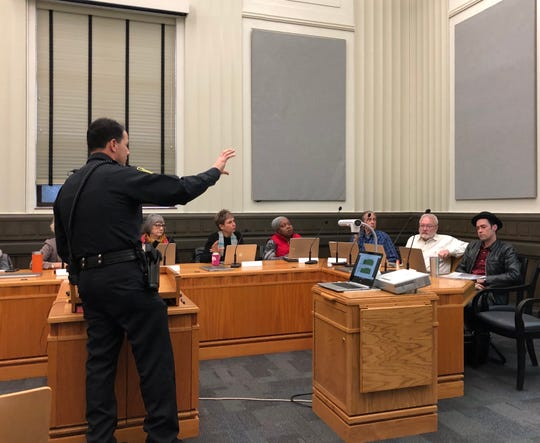 Asheville Police Lt. Mike Lamb explains to the Downtown Commission Jan. 10 the department's plans for a new downtown police district.