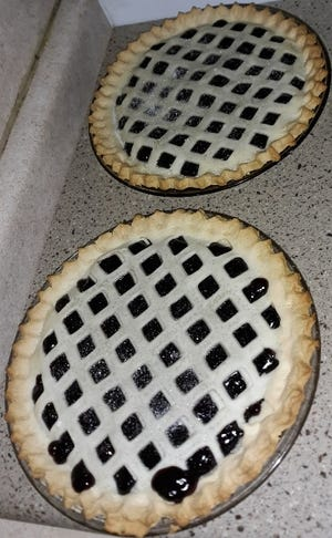 Lovina baked blueberry pies for their family's Sunday dinner at Tim and daughter Elizabeth's house.