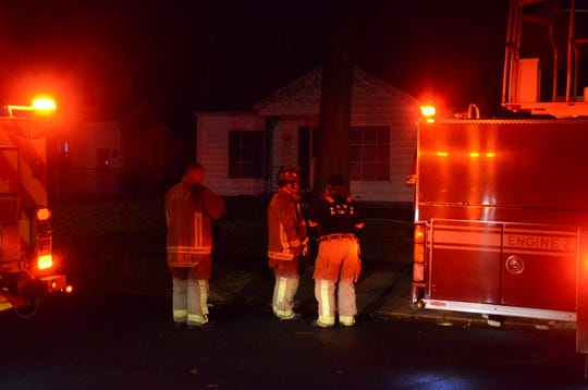 Battle Creek firefighters begin clean-up after fighting a fire at 54 Keith Drive Friday morning.