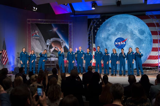 NASA's newest class of astronauts appear on stage during their graduation ceremony at the Johnson Space Center in Houston on Friday, Jan. 10, 2020.