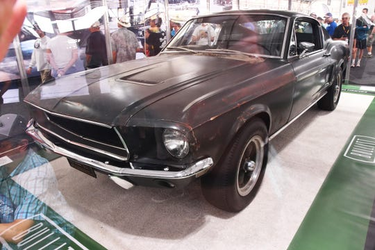 The original 1968 fastback Bullitt Mustang sold for $3.4 million at the Mecum auto auction in Kissimmee Friday. The car had been in the Kiernan family since 1974. The car was on display in a clear case before the auction.