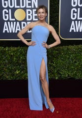 Renee Zellweger arrives at the 77th annual Golden Globe Awards at the Beverly Hilton Hotel on is a sleek blue dress.
