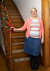 Laura Hostetler stands in the entrance of her Bird's Nest Bed & Breakfast that she started in 2017. Hostetler enjoys hosting and serving others through her bed and breakfast.