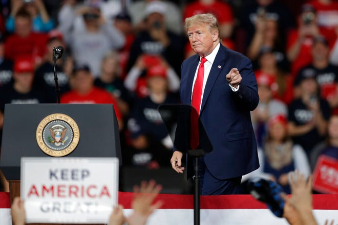 President Donald Trump reacts after speaking during a campaign rally at the Huntington Center, Thursday, Jan. 9, 2020, in Toledo, Ohio. (AP Photo/Tony Dejak)