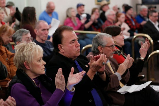"Supporters of the resolution clap as it passes a vote during a Kenton County Fiscal Court meeting at the Kenton County Courthouse in Independence, Ky., on Thursday, Jan. 9, 2020. A resolution was passed during the meeting to declare the county a ""second amendment sanctuary"", a resolution which passes unanimously."
