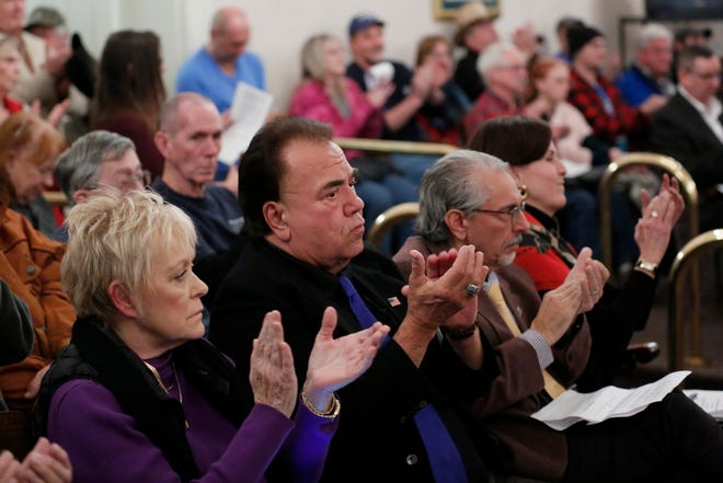 """Supporters of the resolution clap as it passes a vote during a Kenton County Fiscal Court meeting at the Kenton County Courthouse in Independence, Ky., on Thursday, Jan. 9, 2020. A resolution was passed during the meeting to declare the county a """"second amendment sanctuary"""", a resolution which passes unanimously."""
