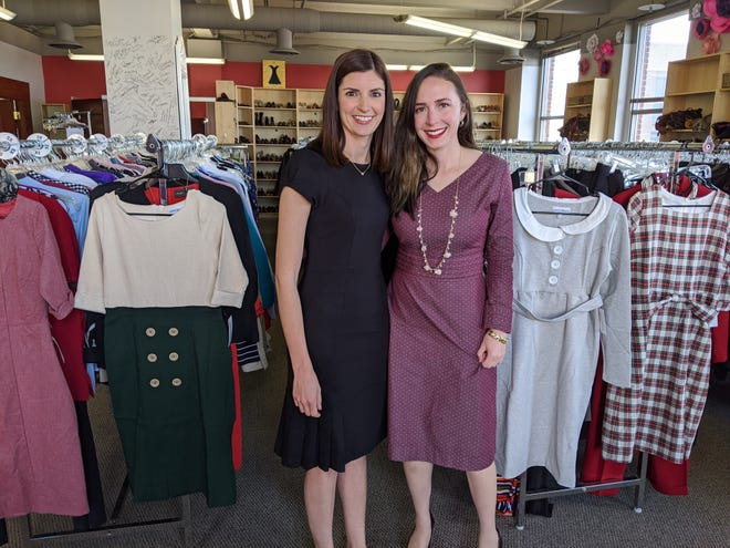 From left: Lisa Nolan, executive director, Dress for Success and Audrey Cole, co-founder, Paris Bloom, with a few of the dresses they will donate.