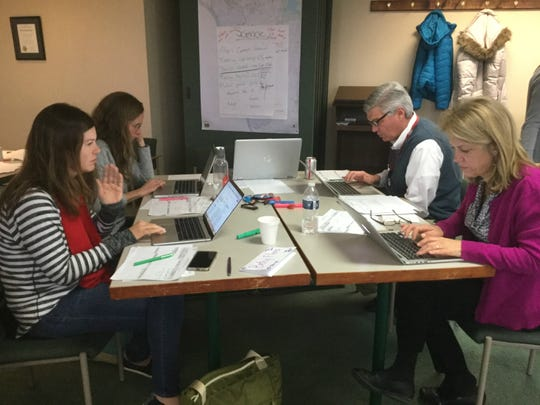 New Richmond Exempted Village School District teachers Betsy Florea, Vicky Phillips, Pat Crowley, and Pam Hughes write curriculum for science.