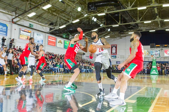 Michael Cobbins #20 of the Capital City Go-Go goes for a shot against Kaiser Gates #22 of the Maine Red Claws on Thursday, January 9, 2020 at the Portland Expo in Portland, Maine.