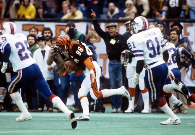 Jan 3, 1982; Cincinnati, OH, USA; FILE PHOTO; Cincinnati Bengals receiver Steve Kreider (86) runs with the ball chased by Buffalo Bills defensive end Ken Johnson (91) and Mario Clark (29) during the 1982 AFC Divisional Playoff game at Riverfront Stadium. The Bengals defeated the Bills 28-21. Mandatory Credit: Manny Rubio-USA TODAY Sports