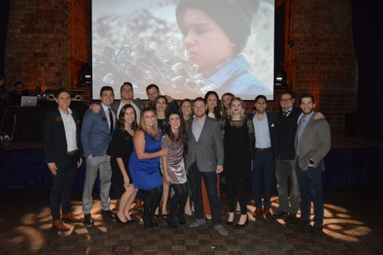 Young professionals celebrate the holidays at the sixth annual Talbert House Ambassadors Holiday Benefit.