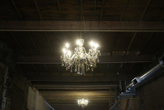 New crystal chandeliers sparkle inside the old Pearson building on Franklin Street on January 10, 2020, which is soon to become the new downtown home to Wedding Belles, a local bridal and formal wear shop in Clarksville.