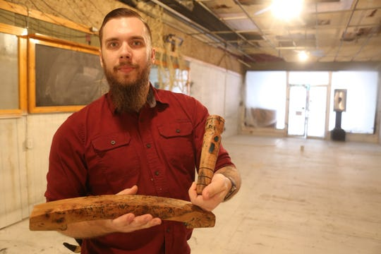 Trazo Mead co-owner Travis Powell shows off some of the woodwork he's crafted for flights and bar taps for their new business on Franklin Street in downtown Clarksville, set to open in a few months.