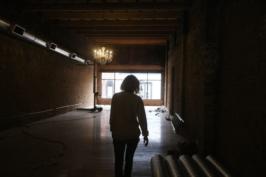 Developer Jennifer Willoughby walks silhouetted by a window on the second floor of the old Pearson building on Franklin Street in downtown Clarksville on January 10, 2020, which she is renovating to become the new home of the local bridal and formal wear business Wedding Belles.