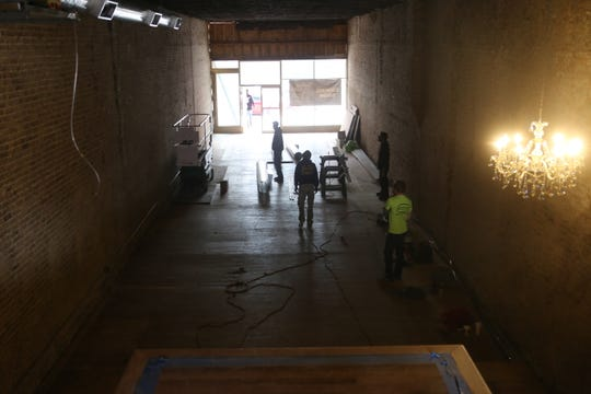Workers putting in duct-work inside the old Pearson building on Franklin Street on January 10, 2020, which is soon to become the new downtown home to Wedding Belles, a local bridal and formal wear shop in Clarksville.