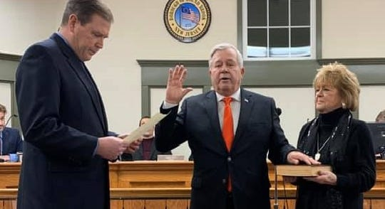 Fellow West Point graduate State Sen. Michael Doherty (R-District 23)  swears in Robert Fazen to a second term as Bound Brook mayor with his wife Lynn holding the Bible.