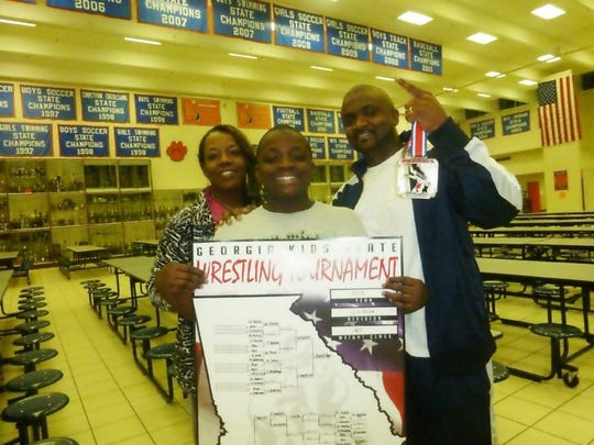 Latrell Bankston with his mom Marcia and dad Tim.