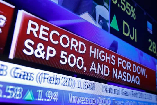 A television screen on the floor of the New York Stock Exchange shows headlines, Thursday, Jan. 9, 2020. Stocks opened broadly higher on Wall Street that day as traders welcomed news that China's top trade official will head to Washington Jan. 15  to sign a preliminary trade deal with the U.S.