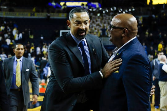 Michigan head coach Juwan Howard is congratulated by athletic director Warde Manuel after 84-78 win over Purdue at Crisler Center in Ann Arbor, Thursday, Jan. 9, 2020.