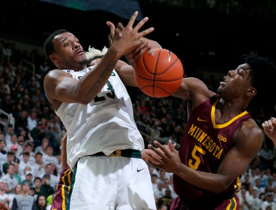 Michigan State's Xavier Tillman and Minnesota's Marcus Carr battle for a rebound during the first half Thursday, Jan. 9, 2020, in East Lansing.