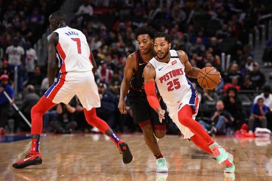 Detroit Pistons guard Derrick Rose against Cleveland Cavaliers guard Darius Garland during the first quarter at Little Caesars Arena, Jan. 9, 2020.
