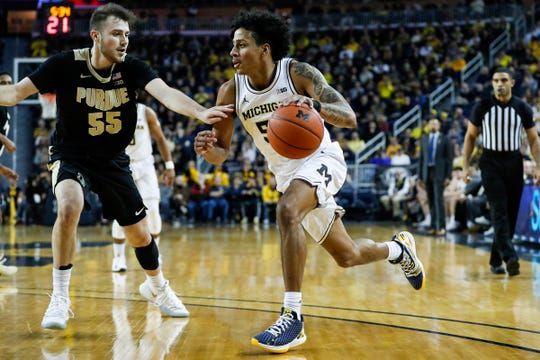 Michigan guard Eli Brooks dribbles against Purdue guard Sasha Stefanovic during the first half at Crisler Center in Ann Arbor, Thursday, Jan. 9, 2020.