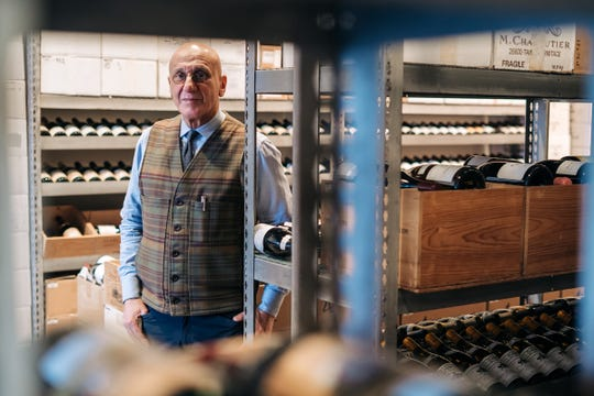 Elie Wine Company owner Elie Boudt stands in his Birmingham shop on Friday. Boudt and others are worried about a proposed tariff of up to 100% on European wines, cheeses and other goods.