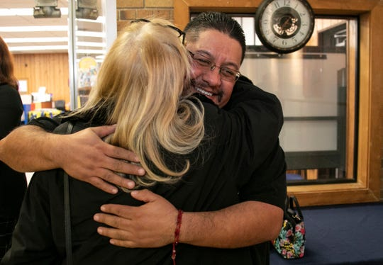 Rep. Debbie Dingell, D-Dearborn, who had just gotten off a plane from Washington hugs Jorge Garcia, 41,  as they gather for a press conference to welcome the once deported Jorge Garcia back to the U.S. and his family at the Lincoln Park Library Friday, Jan. 10, 2020.