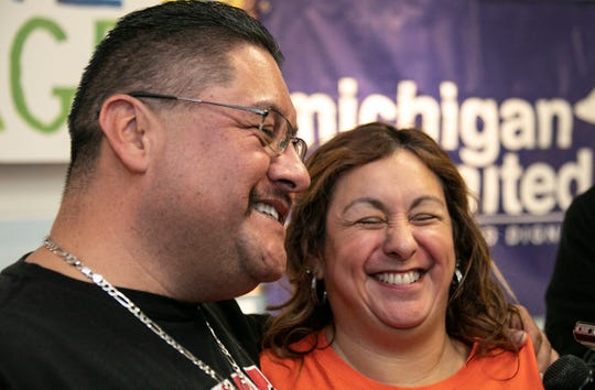Jorge Garcia, 41, shares a laugh with his wife Cindy Garcia,47, after a press conference was held with Rep. Debbie Dingell, D-Dearborn, to welcome the once deported Jorge Garcia back to the U.S. and his family at the Lincoln Park Library Friday, Jan. 10, 2020.