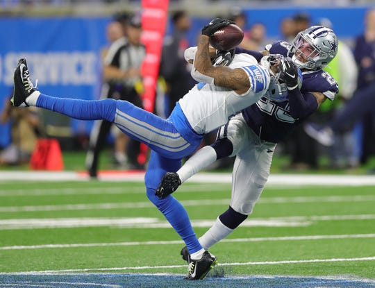 Detroit Lions receiver Kenny Golladay makes a catch against Dallas Cowboys defensive back Darian Thompson during the second half Sunday, Nov. 17, 2019 at Ford Field.