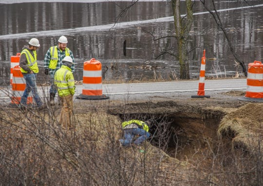 Crews on the scene where a section of northbound I-75 in Grand Blanc was damaged after a plugged drain caused roadway erosion on Friday, January 10, 2020 closing the section of northbound I-75.