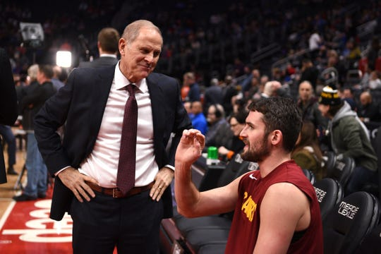 John Beilein talks to Cavs forward Kevin Love prior to the game against the Pistons at Little Caesars Arena, Thursday.