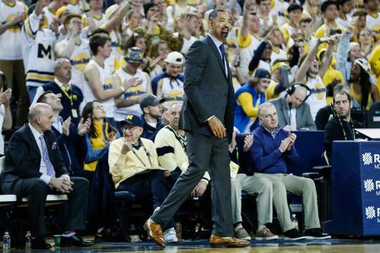 Juwan Howard watches a play against Purdue in the second half.