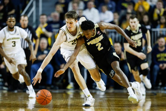 Michigan guard Franz Wagner steals the ball from Purdue guard Eric Hunter Jr. during the first half at Crisler Center in Ann Arbor, Thursday, Jan. 9, 2020.