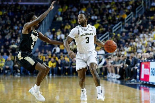 Michigan guard Zavier Simpson dribbles against Purdue guard Eric Hunter Jr. during the first half at Crisler Center in Ann Arbor, Thursday, Jan. 9, 2020.