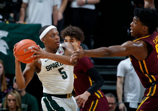 Michigan State's Cassis Winston is pressured by Minnesota's Marcus Carr during the first half Thursday, Jan. 9, 2020, in East Lansing.